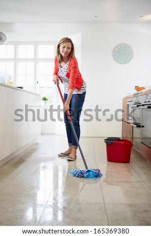 Woman Mopping Kitchen Floor - stock photo