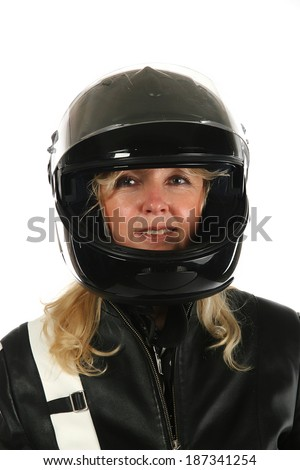 Woman motorcyclist in front of white background.