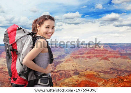 Woman mountain Hiker with backpack enjoy view in grand canyon, asian - stock photo