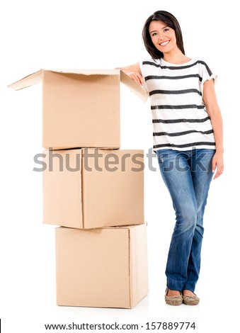 Woman moving house and packing in boxes - isolated over white  - stock photo