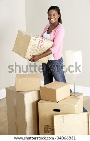 Woman Moving Into New Home - stock photo