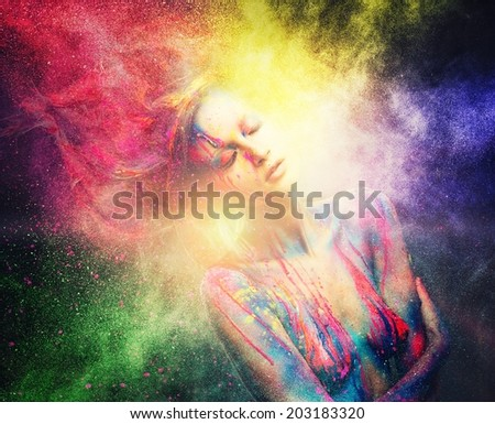 Woman muse with creative body art and hairdo in colourful powder explosion   - stock photo