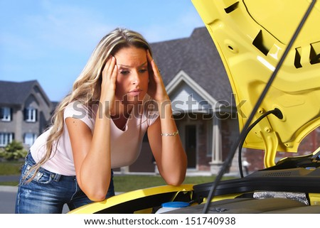 Woman near broken car. Auto repair service concept. - stock photo