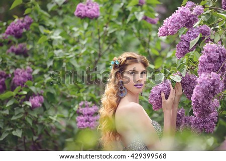 woman near lilac bush