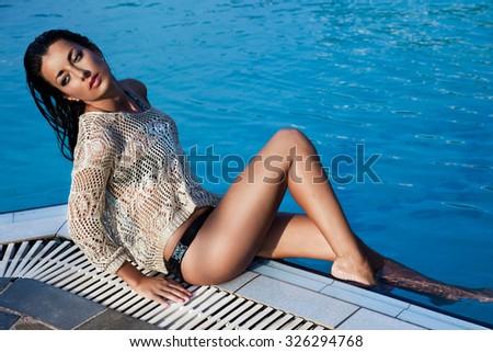 woman near the swimming pool - stock photo