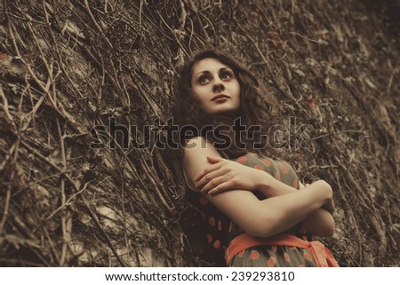 Woman near the wall - stock photo