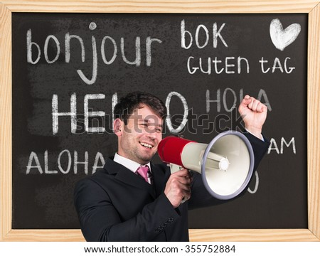 Woman near words hello in different languages on chalkboard - stock photo