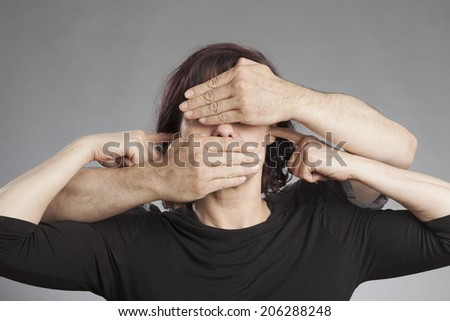 Woman not seeing not hearing not saying anything - stock photo