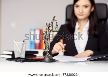 Woman notary public  stamping the document. Notary public concept - stock photo