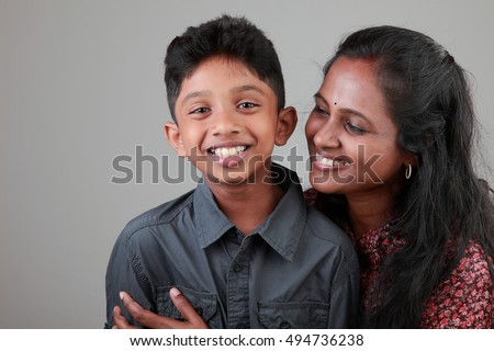 Woman of Indian origin and her son with smiling expression