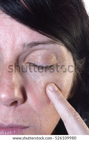 Woman of tiddle aged with wrinkles on face 40-45 years,