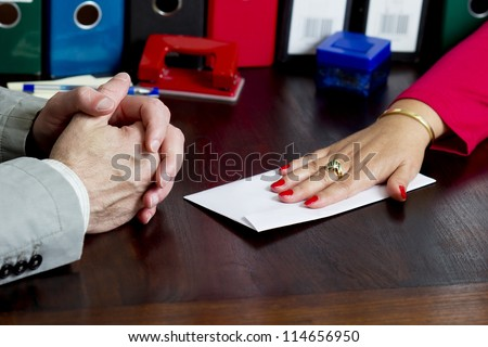 Woman offering a bribe in the envelope - stock photo