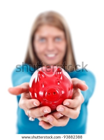 Woman offering a red piggy bank for us, focus on it