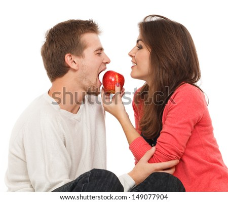 woman offers the man an apple