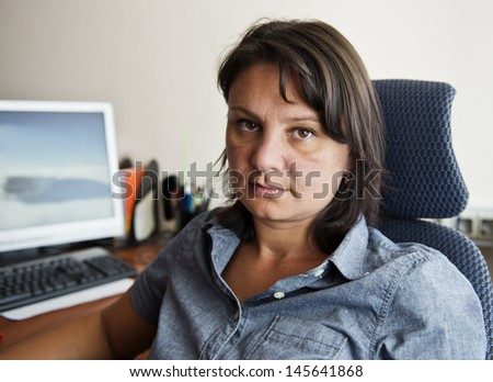 Woman office worker at her workplace. Real people series. - stock photo