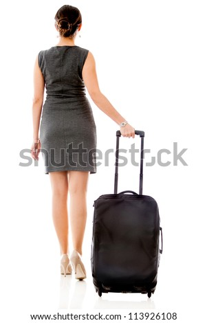 Woman on a business travel carrying her bag - isolated over a white background - stock photo