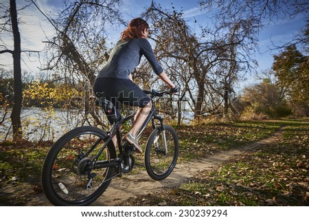 woman on a mountain bike - stock photo