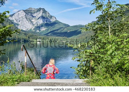 Woman on a stairway to lake Langbathsee in Austria, Salzkammgut in front of the mountains