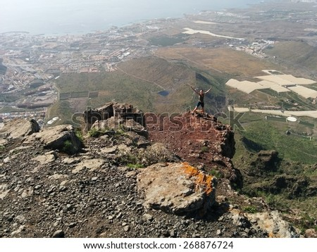 Woman on a top of a mountain. Tenerife, Canary Islands, Spain - stock photo