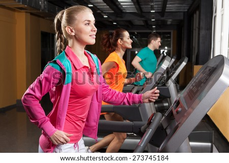 woman on a treadmill in the gym - stock photo