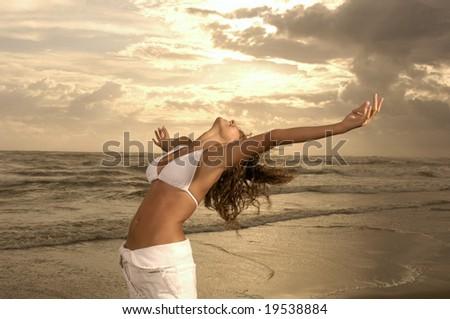 Woman on a winter beach - stock photo