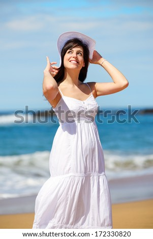 Woman on beach summer vacation. Relaxing girl enjoying summertime lifestyle.