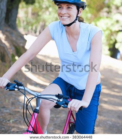 woman on bike - stock photo