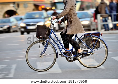 Woman on bike in profile - stock photo