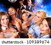 Woman on disco in night club. Lighting effects. - stock photo