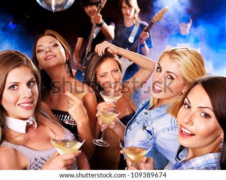 Woman on disco in night club. Lighting effects. - stock photo