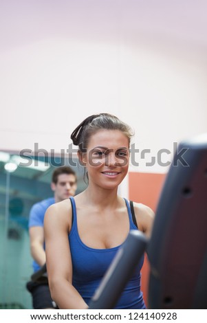 Woman on exercise bike in spinning class in gym - stock photo