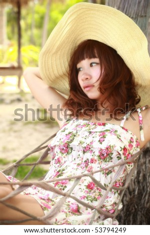 woman on hammock  at the beach in Thailand. - stock photo