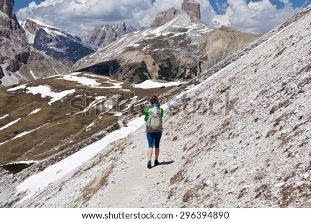 woman on hiking trail in Dolomiti mountains - Italy