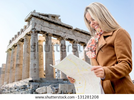Woman on holidays holding a map in Athens, Greece - stock photo