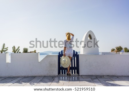 Woman on holidays in Santorini Greece