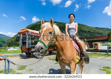 Woman on horse in countryside