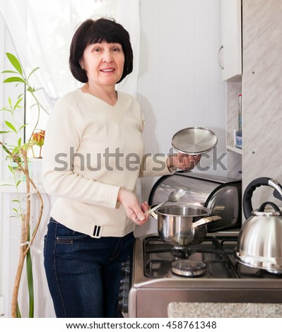Woman on light kitchen at home.