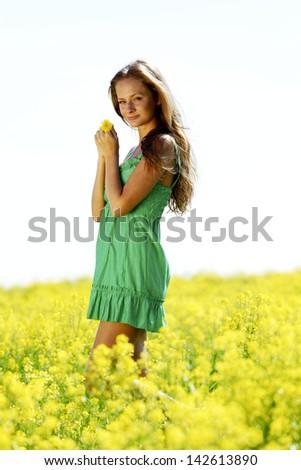 woman on oilseed field close portrait - stock photo