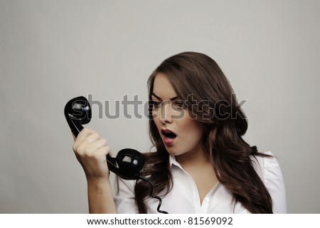 woman on old telephone looking surprised - stock photo
