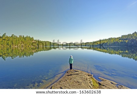 Woman on Ottertrack Lake in the Boundary Waters - stock photo