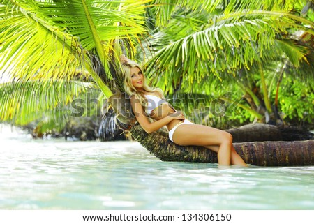 woman on palm sea on backgroud - stock photo