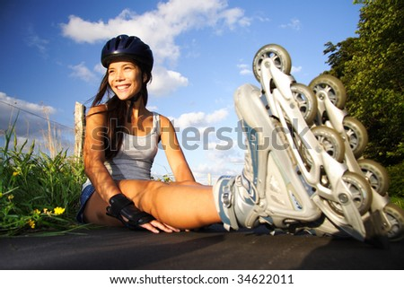 Woman on rollerblades taking a rest on a sunny day. - stock photo