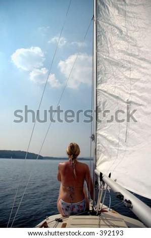 woman on sailboat - stock photo