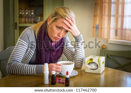 woman on sick leave with tea and medicines. cold, cold and flu season - stock photo