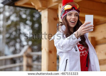 Woman on ski vacation taking a selfie