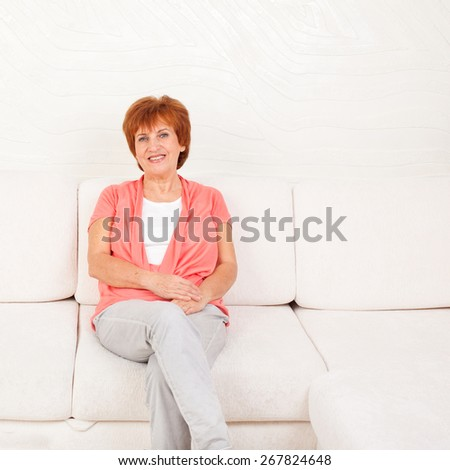 Woman on sofa at home. Adult female  - stock photo