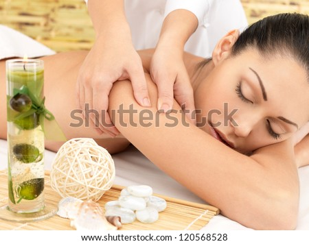 Woman on spa massage of body in the beauty salon. - stock photo