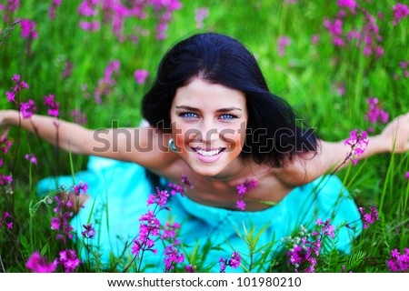woman on summer flower field - stock photo