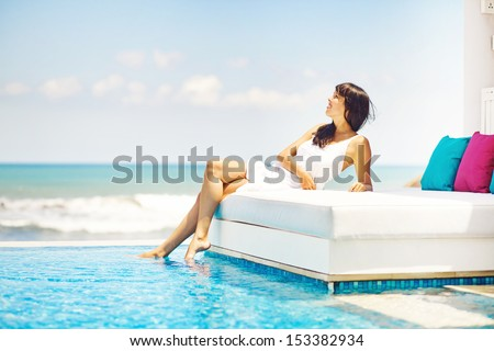 woman on sunbed - stock photo