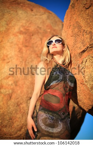 Woman on the background of rock, Devils Marbles,Northern Territory,  Australia - stock photo